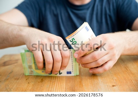 Counting money for a rent. Saving money concept. Finance, business, investment. Keeping savings at home. Spending cash for unexpected expense, unplanned losses, real estate, debts, taxes. Royalty-Free Stock Photo #2026178576