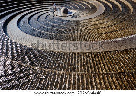 The Darling Harbour Woodward Water Feature is a heritage-listed water fountain located at Harbour Promenade, Darling Harbour, City of Sydney, New South Wales, Australia. Royalty-Free Stock Photo #2026564448