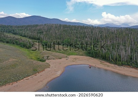 Aerial view of family and friends enjoying afternoon boating on Lake Granby in Arapaho National Recreation Area, Colorado on sunny summer day. Royalty-Free Stock Photo #2026590620