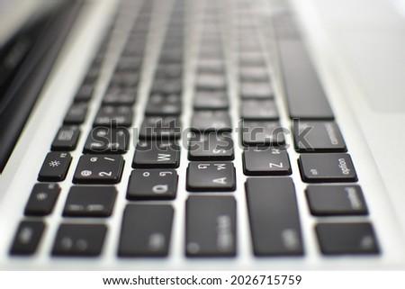 gradation of sharpness on laptop keypad. black keypads. Royalty-Free Stock Photo #2026715759