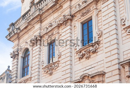 exquisite baroque work leccese exterior of the facades of the palazzo del seminario, emphasis on the rich framing of columns and balusters of the balcony of the museum Royalty-Free Stock Photo #2026731668