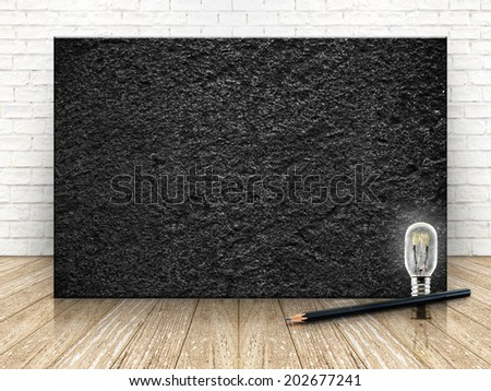 Black stone on the white  brick wall and the wood floor,template for your content