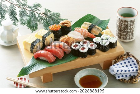 This is a picture of Japanese food with cup of green tea