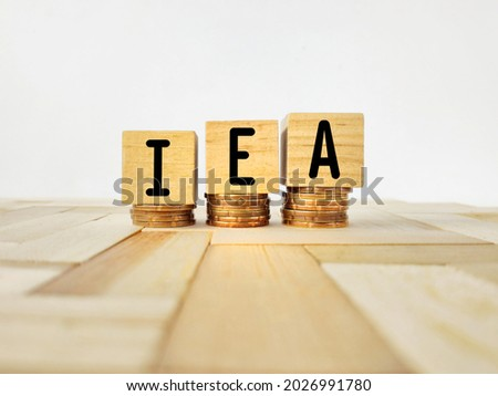 IEA text on wooden blocks background. Stands for International Energy Agency. Stock photo.