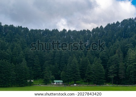 Picture of khajjiar himachal with cloudy weather.