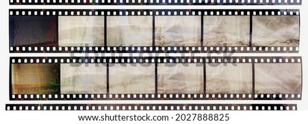35mm positive filmstrips with empty frames, real scan of film material with cool scanning light interferences on the material. retro photo placeholder. Royalty-Free Stock Photo #2027888825