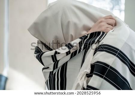 Religious jew prays in a tallit. Jewish prayer Royalty-Free Stock Photo #2028525956