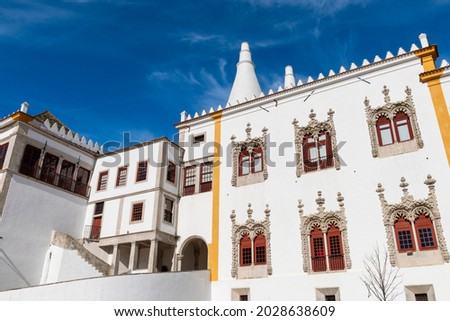 View of the facade of the National Palace of Sintra (Palacio Nacional de Sintra) with the Manueline style windows, in Sintra, Portugal. Royalty-Free Stock Photo #2028638609