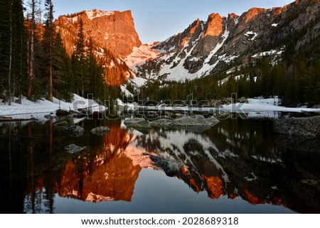Rockies Mountains Reflected Off Dream Lake at Sunrise Royalty-Free Stock Photo #2028689318