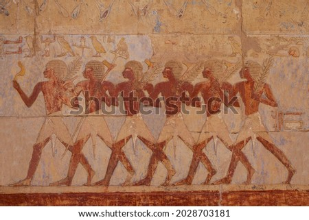 Egyptian soldiers in the expedition to the Land of Punt at the Temple of Hatshepsut. Luxor .Egypt.  Royalty-Free Stock Photo #2028703181