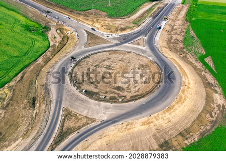 Infrastructure construction. New ring road junction at the final stage of construction. Drone view Royalty-Free Stock Photo #2028879383