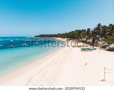 Daku Island white sand beach in Siargao Island Surigao del Norte Mindanao Philippines with turquoise blue sea water on a sunny day island hopping Royalty-Free Stock Photo #2028994532
