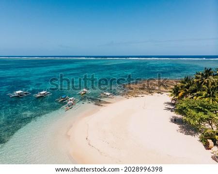 Guyam Island white sand beach in Siargao Island Surigao del Norte Mindanao Philippines island hopping tour boats and turquoise blue sea water Royalty-Free Stock Photo #2028996398