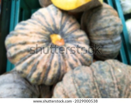 Picture blur of Golden yellow flesh pumpkin placed in a basket, pumpkin blur background.