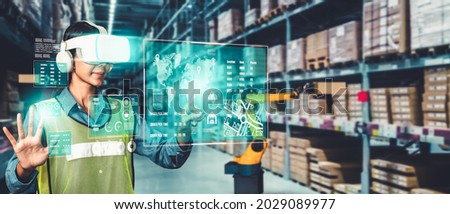 Future virtual reality technology for innovative VR warehouse management . Concept of smart technology for industrial revolution and automated logistic control . Royalty-Free Stock Photo #2029089977