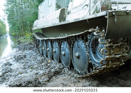Dirty all-terrain vehicle tracks, caterpillar truck after working in swampy terrain Royalty-Free Stock Photo #2029105031