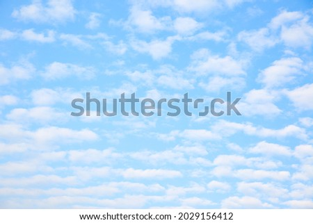 Multitude white small clouds in the sky , may be used as background Royalty-Free Stock Photo #2029156412