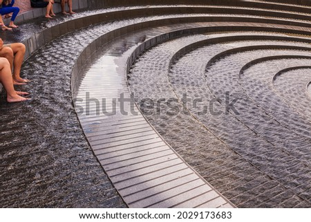 The Darling Harbour Woodward Water Feature is a heritage-listed water fountain located at Harbour Promenade, Darling Harbour, City of Sydney, New South Wales, Australia. Royalty-Free Stock Photo #2029173683