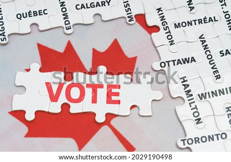 National concept. The flag of Canada features city name jigsaw puzzles and jigsaw puzzles with the words - Vote