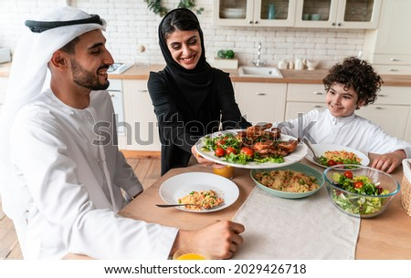 happy family from arab united emirates eating together and celebrating the national day holidays Royalty-Free Stock Photo #2029426718