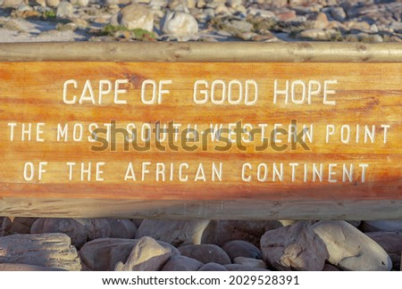 Cape of Good Hope the south-western most point of the African continent - an inscription on  wooden shield on the shore of the cape near the water.  An nformation sign about   geographical point  Royalty-Free Stock Photo #2029528391