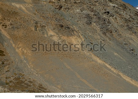 The arid mountains. Closeup view of the arid desert rock formation in the Andes cordillera.  Royalty-Free Stock Photo #2029566317