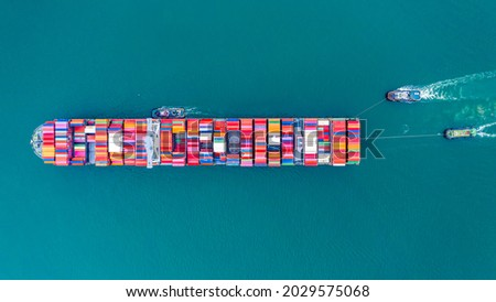 Aerial top view of International Containers Cargo ship in ocean, Freight Transportation,Shipping,Nautical Vessel. Logistics import export Container Cargo ship over sea. OverseaTransport business. Royalty-Free Stock Photo #2029575068