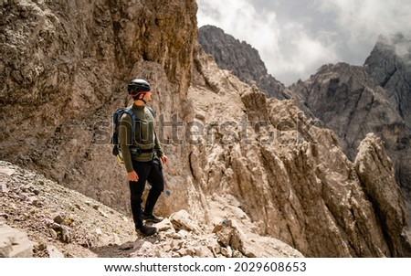 The sequential walking concepts of professional mountaineer to the summit. Tourist on the rock. Sport and active life concept Royalty-Free Stock Photo #2029608653