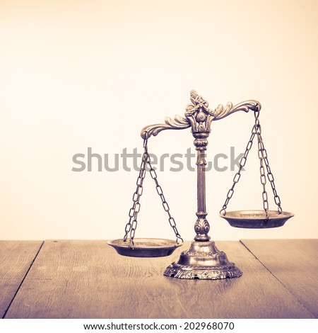 Law scales on table. Symbol of justice. Retro style filtered photo