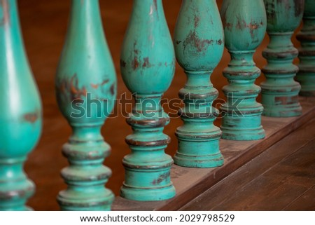 Wooden balusters on the old historic railings. Lots of old balusters. An architectural element of an old building. Royalty-Free Stock Photo #2029798529