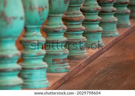 Wooden balusters on the old historic railings. Lots of old balusters. An architectural element of an old building. Royalty-Free Stock Photo #2029798604