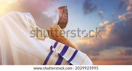 Jewish man blowing the Shofar (horn) of Rosh Hashanah (New Year). Religious symbol Royalty-Free Stock Photo #2029923995