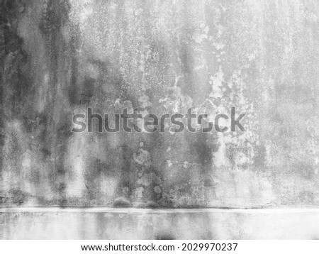 The old cement wall was weathered, the surface was scratched, the surface was scratched and damaged. For a mysterious retro-conservative background. Royalty-Free Stock Photo #2029970237