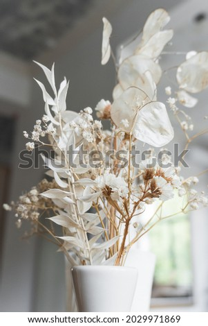 Beautiful dried flower arrangement in a stylish vase Royalty-Free Stock Photo #2029971869