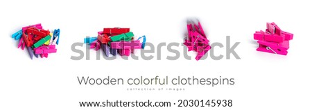 Wooden colorful clothespins isolated on a white background. High quality photo Royalty-Free Stock Photo #2030145938