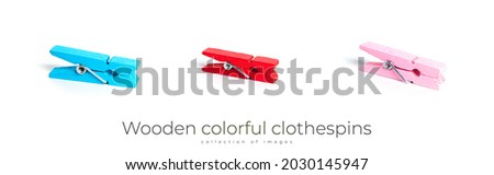 Wooden colorful clothespins isolated on a white background. High quality photo Royalty-Free Stock Photo #2030145947
