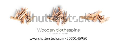 Wooden clothespins isolated on a white background. High quality photo Royalty-Free Stock Photo #2030145950