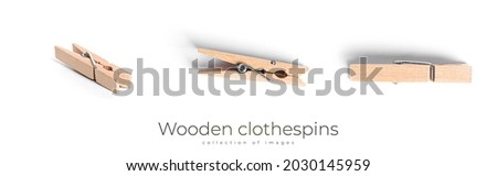 Wooden clothespins isolated on a white background. High quality photo Royalty-Free Stock Photo #2030145959