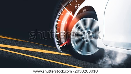 Race car start on track and burning tire,speedometer indicator sweeping to 60 mph,Double exposure concept and copy space Royalty-Free Stock Photo #2030203010