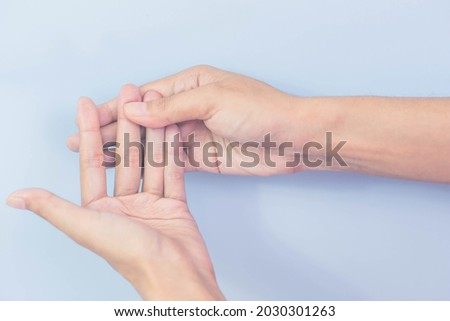 Female hands with pain, numbness, or weakness. Caused by peripheral neuropathy or degeneration.
