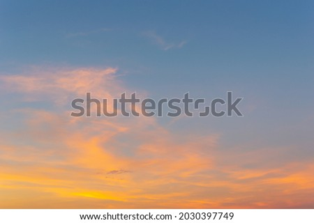 Beautiful Vivid sky painted by the sun leaving bright golden shades.Dense clouds in twilight sky in winter evening.Evening Vivid  sky with clouds. Royalty-Free Stock Photo #2030397749