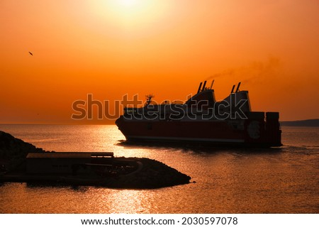 Ferry vessel in sea departing port of Marseille for Corsica on sunset. Marseille, France Royalty-Free Stock Photo #2030597078