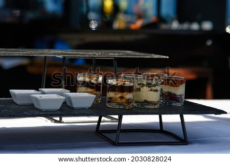 Black buffet table with beautiful decorated dishes. Breakfast at hotel. Catering. Decoration for a Banquet. High quality photo Royalty-Free Stock Photo #2030828024