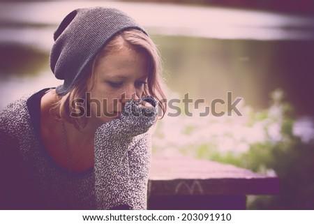 Woman feeling so alone Royalty-Free Stock Photo #203091910