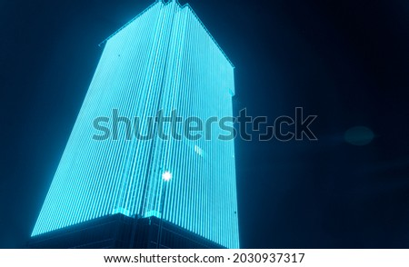 LED outdoor media facade, digital signage screen. Exterior facade light on tall office building, LED wall lamp, architectural media lighting.