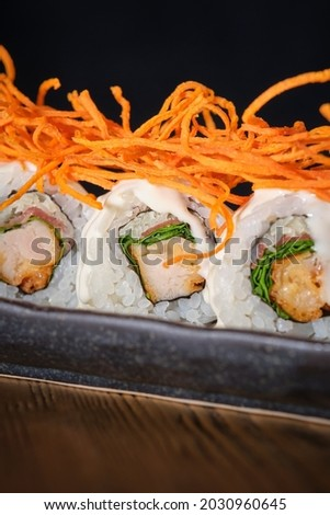 Deep fried battereDeep fried battered chicken sushi, serrano, parmesan and lettuce. Topped with Caesar sauce and fried sweet potato chips.d chicken sushi, serrano, parmesan and lettuce. Topped with