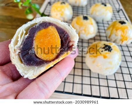 Chinese moon cake pastry with red bean paste and salted egg yolk Royalty-Free Stock Photo #2030989961