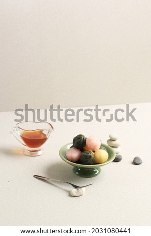 Three Color Kkultteok is Ball Shaped Rice Cake Filled with Honey and Sesame Syrup, Korean Traditional Cake for Chuseok Day. Concept Korean Culture Royalty-Free Stock Photo #2031080441