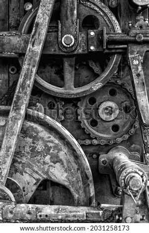 An abstract detail view of a historic wood saw and mill for cutting logs Royalty-Free Stock Photo #2031258173