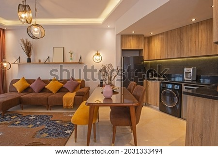 Living room lounge area in luxury apartment show home showing interior design decor furnishing with kitchen Royalty-Free Stock Photo #2031333494